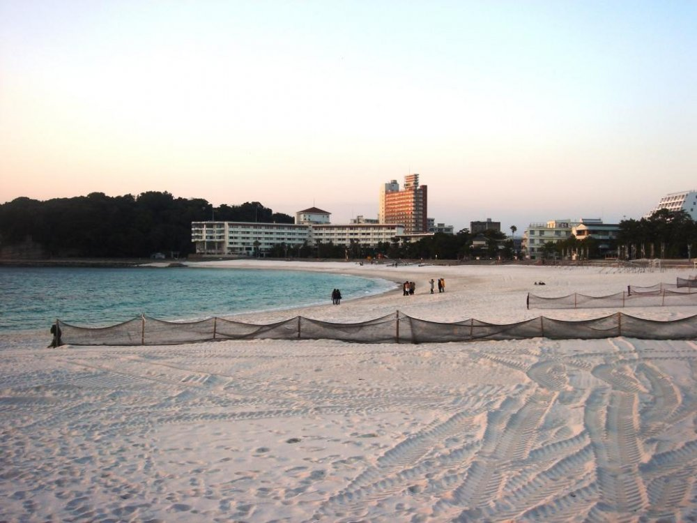 A long white sandy beach awaits guests at Shirahama Onsen