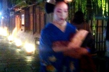 Was she a geisha that walked past a fleeting moment of Night beauty at Gion Shirakawa in Springtime