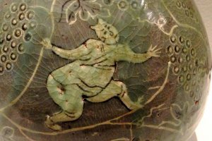 A Romanesque painting of a boy amongst the grape vines at the Museum of Oriental Ceramics Osaka