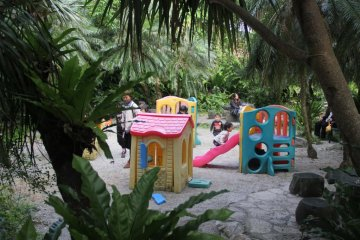 <p>Children take a break at a mini playground at the Mini Mini Zoo and Zukeran Egg Outlet in Uruma City Okinawa.</p>