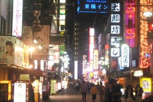 The streets are lit up with Neon signs at Juso the crossroads between Umeda Itami Kyoto and Kobe with Toyoko Inn the highest building on this street