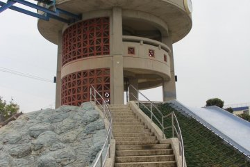 <p>The slide begins from the thrid story of an observation tower that is elevated about five meters above the level of the rest of Manta Park</p>