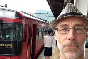 In Beppu, ready to head for Oita and Yunohira, wearing my Torasan hat