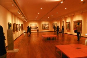 Visitors tour the permanent collection