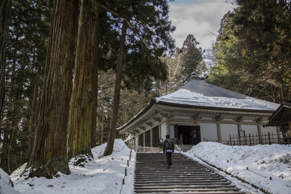 The nondescript steps leading up to Chuson-ji's gold-covered Konjikido transforms into a white stairway in winter — perfect for photos