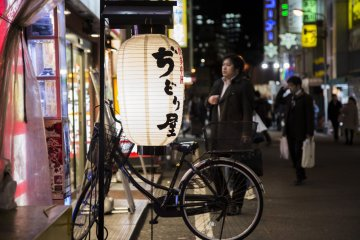In the back alleys of Akihabara, soft lighting can be used to draw attention