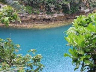 The lush blue water between Yakena Island and Okinawa Island is beautiful and representative of scenic shorelines throughout the prefecture