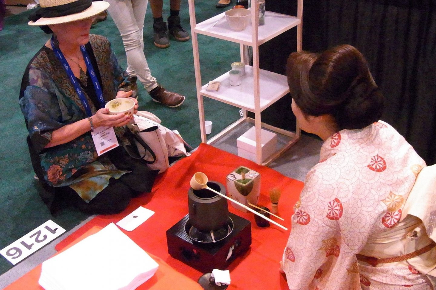 Rie Takeda, founder of Chazen, serving tea to a visitor at the World Tea Expo (U.S.)