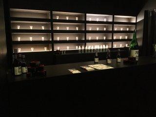 The chic sake bar, in full swing at night.