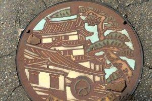 Wild plants add some wabi sabi to Sekiyado manhole covers