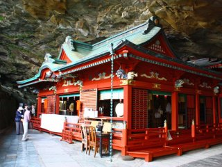The main building fits snugly in the cave. A pair of breast-shaped rocks around the back of the building are thought to bring luck to pregnant women, who can drink the fresh water that drips from them.