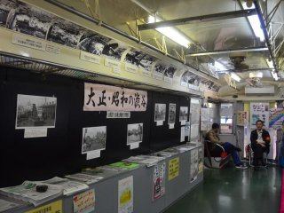 """Inside of the  """"green frog"""" there are many photos on display of Shibuya throughout the years and some information brochures are also provided. Admission is free and the car is open to the public from 10 AM to 6 PM."""