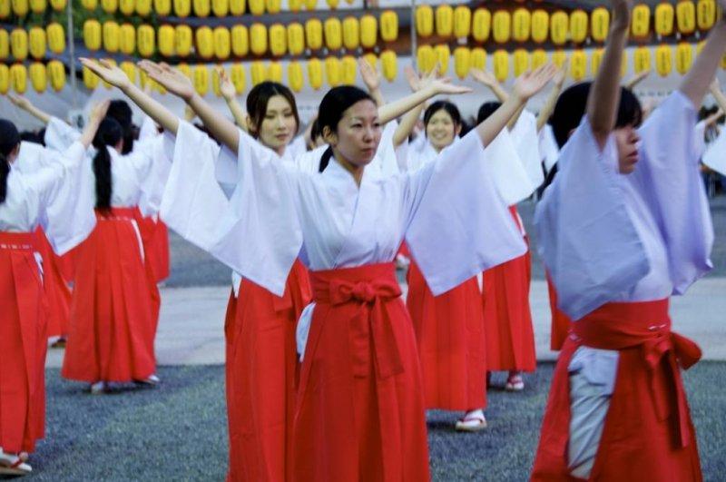 100 local ladies become shrine maidens for the evening to dance in at Hiroshima Gokoku-jinja Shrine