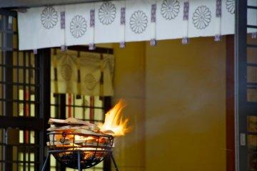"Then a ritual lightng of the ""kagaribi"""