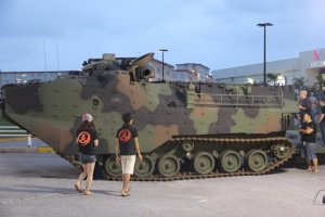 Visitors look at a static display of an advanced amphibious assualt vehicle