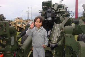 The reviewer's son posing with a howitzer