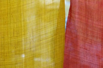 colorful noren curtain in front of the kitchen