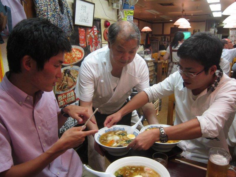 Lovely store owner serving us bowls of ramen