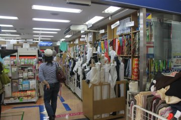 Entrance into the fabric store. Even from the outside, you can see the rows and rows of fabric.