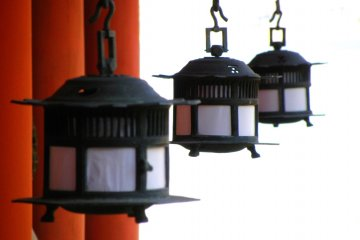 Tsuri-doro hanging lanterns in the shrine complex. In a holy space, the white light of heaven is all around.