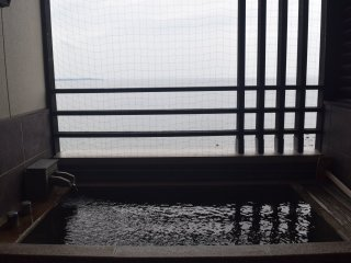 Some rooms include an open air balcony onsen with Beppu Bay views