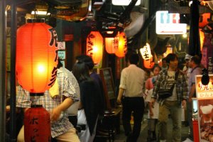 The Alley: A blaze of neon and the glow of red lanterns