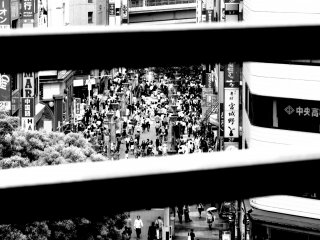 There is a lot of movement beyond these bars in east Ikebukuro