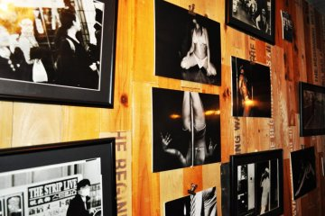 The photographs of erotic dancers on the walls.