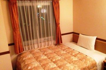 Toyoko Inn Shinagawa - Pastel colors give a homely feel