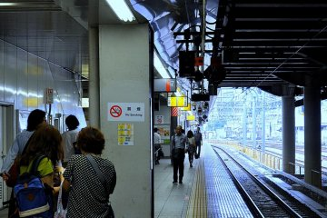 Travelers await the next train