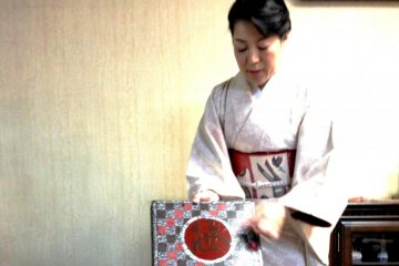 Mrs Tamaru explains the bird shaped crest which is also a Kanji character on the Kyogashi Box