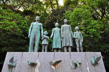 A statue near the entrance of the shrine. I think this statue is dedicated to peace, given that the girl is releasing a dove from her hands.