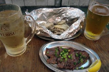 Try new foods like gyūtan (grilled beef tongue) with grilled mushrooms.