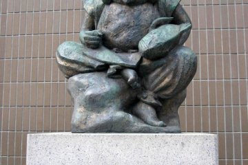 Statue of Ebisu located next to the station.