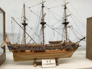 Intricately detailed model ships on display.