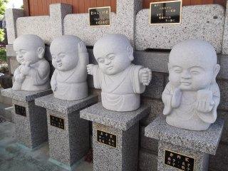 Cute baby-faced statues