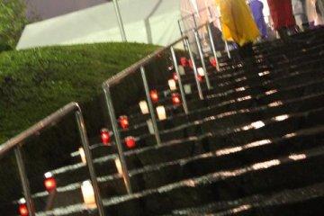 Sparks of fire light up the steps to Zozoji Temple Tokyo