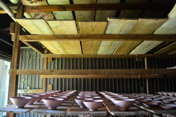 Teabowls that are ready to be fired inside the kiln.