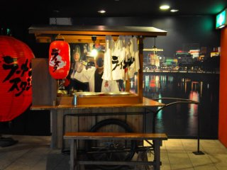 "Photo op: a yatai on display at the entrance of the ""stadium.' Fukuoka is famous for these informal food stalls that are set up every night on the streets and serve food such as ramen."