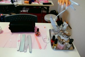 Students improve their skills by practicing with professional nail art tools