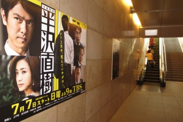 Drama posters lining the walls leading to TBS headquarters
