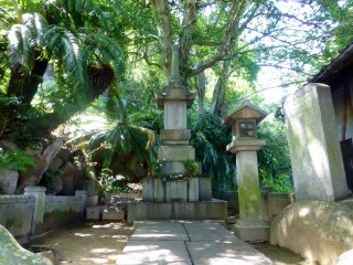 Gravestones and monuments are tucked within the trees all around the mountain