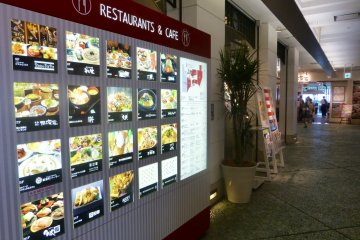 A big bright visual menu greets you at the entrance to the restaurant level