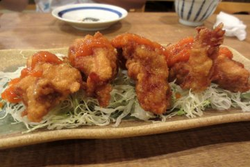 Spicy fried chicken on cabbage - one of the summer specials