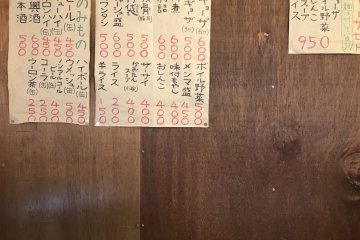 You won't find menus on the tables - they're just written on paper pinned to the wall