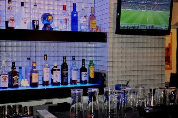 Drinks and small TV behind the bar