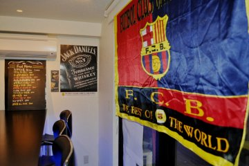 FCBarcelona flag in a corner of the bar