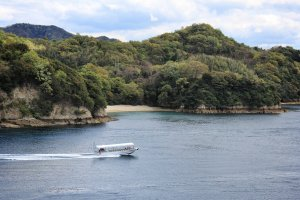 A pleasure boat races down the channel near Funaori campsite