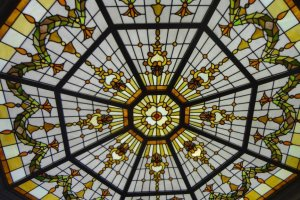 Lovely stained glass sunlight in the ceiling.