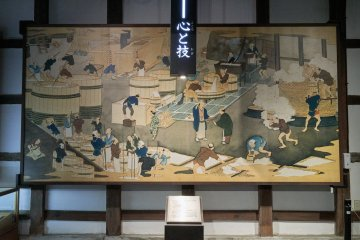 A mural depicting the history of sake making